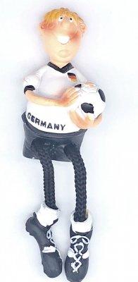 Fußballspieler mit Schlenkerbeinchen